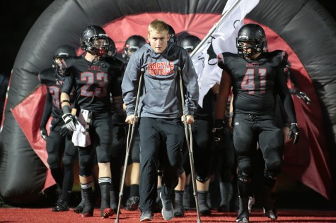 Senior Sam Sizelove Leads Team out at last District Home Game Against Celina