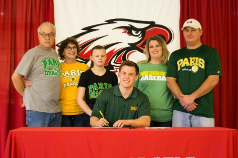 Cutter McDonald signs to Paris Junior College on National Signing Day at Argyle High School on Feb. 4, 2015. (Photo by Caleb Miles / The Talon News)