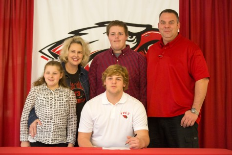 Matt Hiter signs at National Signing Day at Argyle High School on Feb. 4, 2015. (Photo by Caleb Miles / The Talon News)