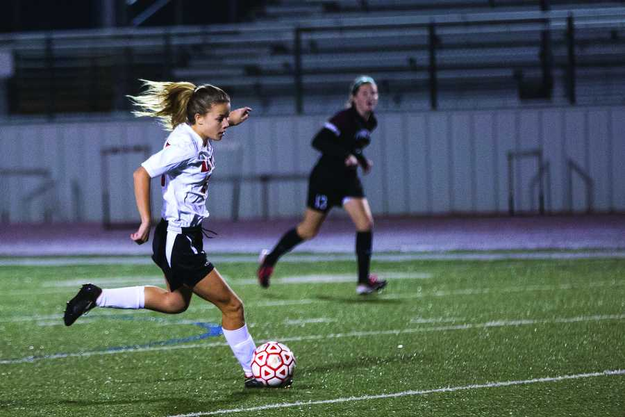 Junior Abbi Neece advances the ball for an Eagle score against Princeton High  School on Feb. 17. (Caleb Miles / The Talon News)