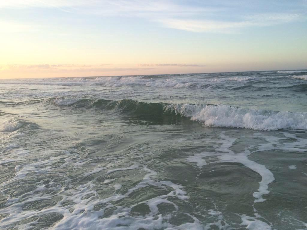 Waves roll in on the beaches of Florida in the evening while the sunsets. (Erin Eubanks / The Talon News)