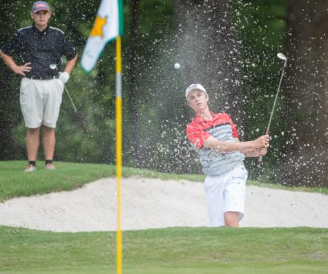 Argyle's Alex Isakson chips the ball from the bunker in the UIL state golf tournament at the Onion Creek Golf Course in Austin, Texas on April 27, 2015. (Christopher Piel/The Talon News)