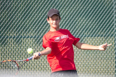 Matt Hynek returns the ball in a district tennis match on September 15, 2015 at Argyle High School in Argyle, Texas. (Christopher Piel/The Talon News)
