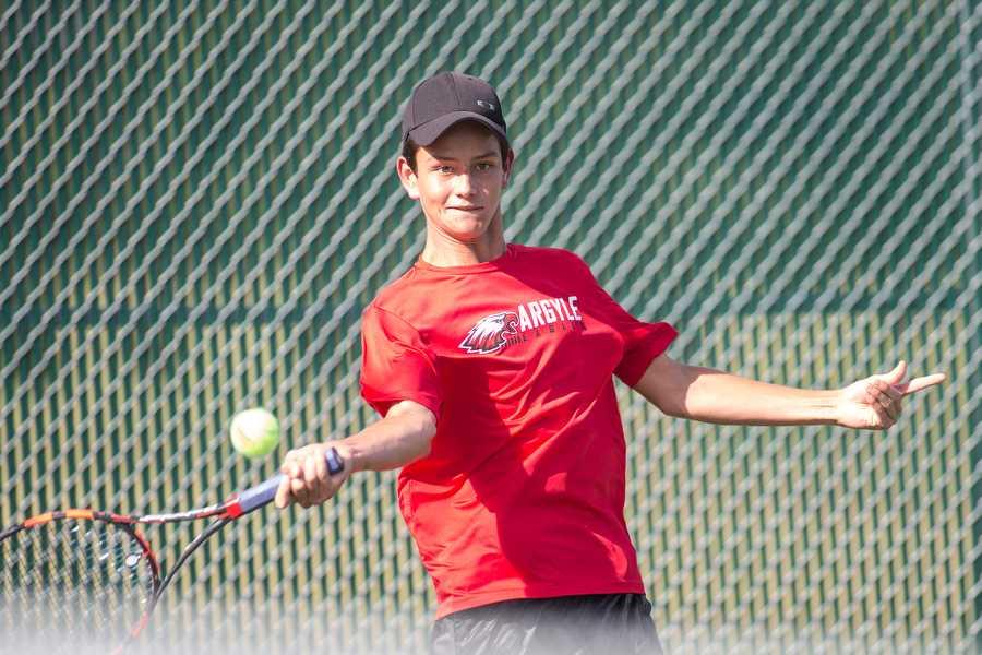 Matt Hynek returns the ball in a district tennis match on September 15, 2015 at Argyle High School in Argyle, Texas. (Christopher Piel/The Talon News)