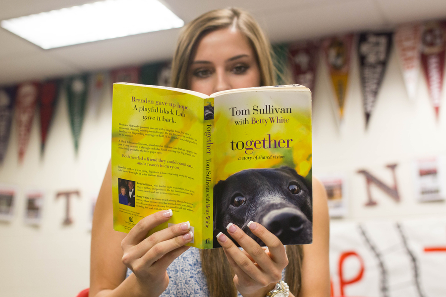 Junior Lizzie Dagg reads Together: A Story of Shared Vision, by Tom Sullivan and Betty White on September 26, 2016 in Argyle High School (Faith Stapleton/The Talon News)