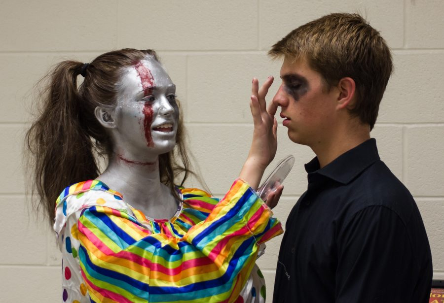 Maddison Darnell and Jared Dureau put finishing touches on makeup before the haunted house. (GiGi Robertson/The Talon News)