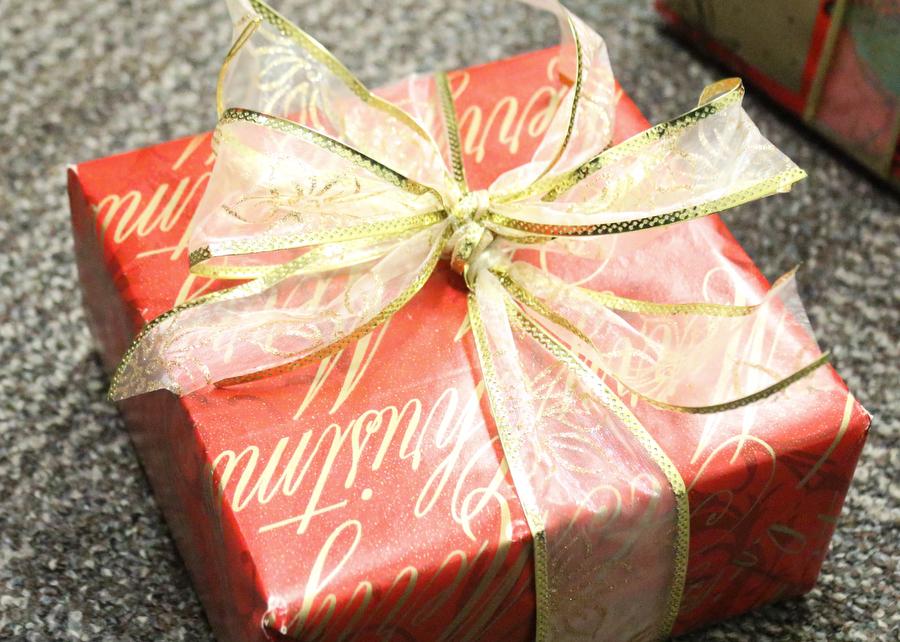 A wrapped present with a bow on top sits on the ground  at Argyle High School on December 13, 2016 in Argyle, Texas. (Faith Stapleton/ The Talon News)