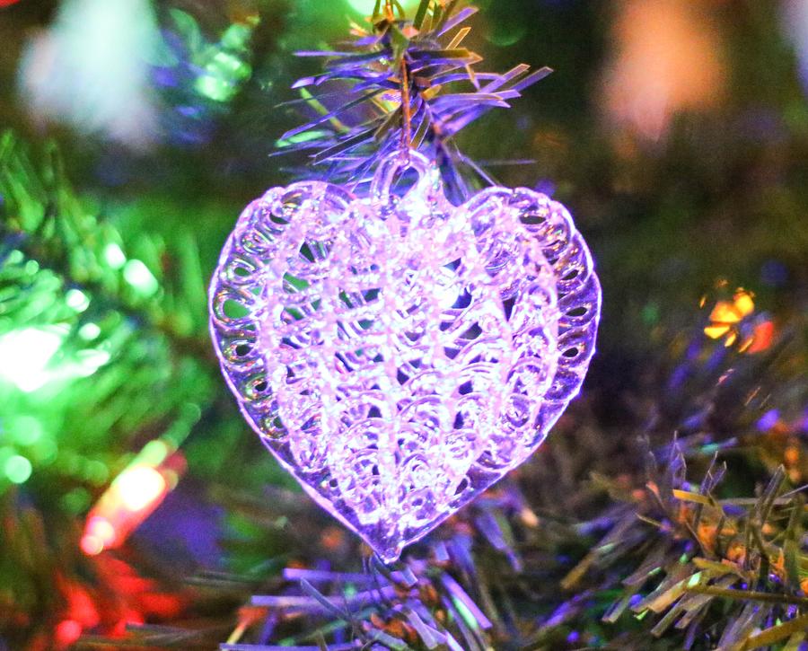 A glass heart ornament hangs off of a seven foot Christmas tree on November 30, 2016 in Argyle, Texas. (Faith Stapleton/ The Talon News)