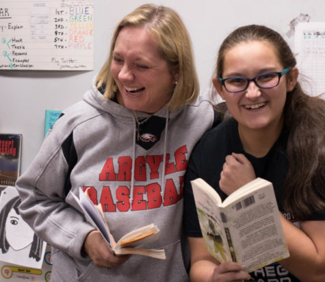 Sutton shares a laugh with freshman Katy Atkins on December 13, 2017. (Hayden Calendine | The Talon News)