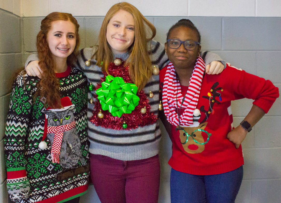 As they show off their extravagant sweaters, freshman pose for a photo on December 15, 2017. (Katy McBee | The Talon News)