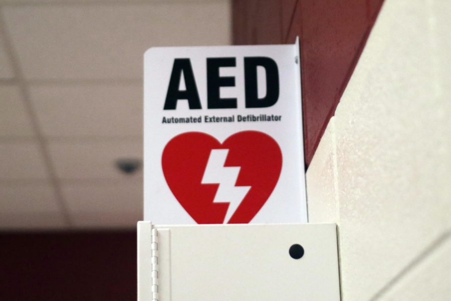 The AED machine located near the 100 hallway is one of the many positioned around the school. (Jaclyn Harris / The Talon News)