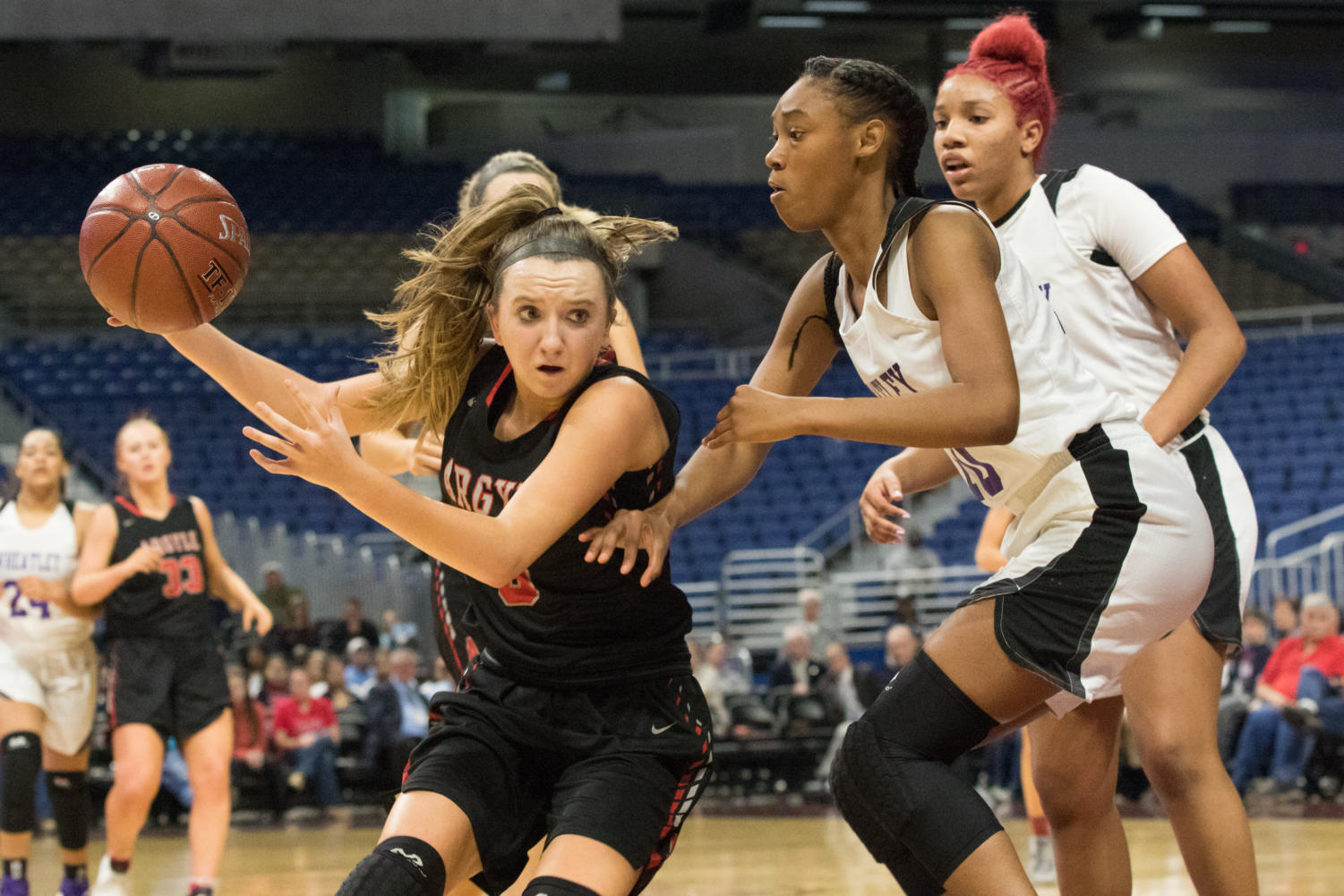 The Lady Eagles Rhyle McKinney drives to the goal in the state semi final game against  Houston Wheatley in the UIL 4A State Semi-Final game, finishing the game with a winning score of 62-46. The team plays in the championship game against Veteran's Memorial tomorrow in the Alamodome at 7pm. (Campbell Wilmot/ The Talon News)