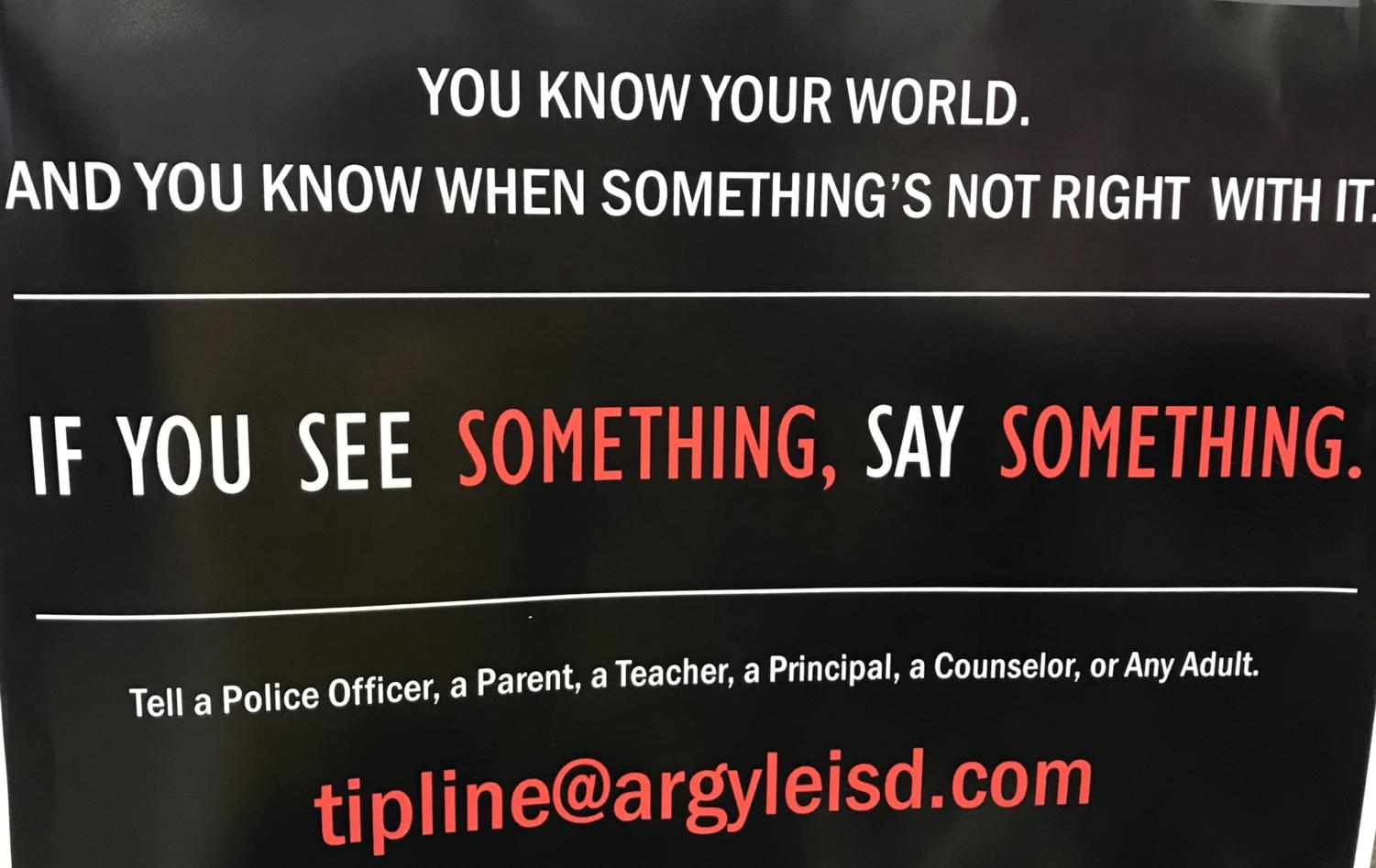 Posters hang in classrooms and hallways displaying the tipline students can submit information to at Argyle High School in Argyle, TX on April 18, 2018. (Miranda Downe/The Talon News)