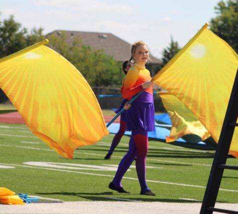 Color Guard member Lindsey Kennedy performs in the Argyle Marching Band show 'Vernal Equinox'. (Photo by: Britt Flaten)
