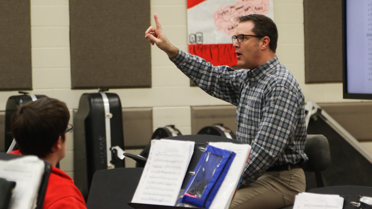 Golden Eagle, Asa Burk, directs the Symphonic Band in preparation for the Spring Concert on April 29, 2018 in Argyle, Tx. (Katie Ray / The Talon News)