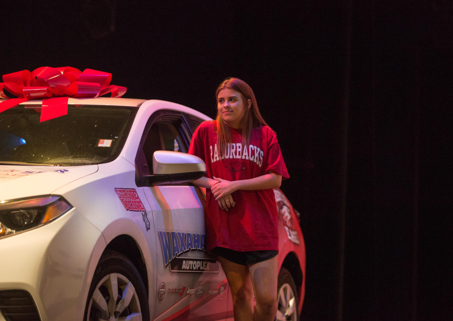 Sophomore Isabelle Adoue stands next to the free car she won for her perfect attendance throughout the year on May 21, 2018 in Argyle, Tx. (Sarah Berney / The Talon News)