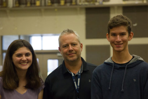Welcoming the new band director,  students Kian Nawaby and Trinity Flaten smile with Jason Bird  at Argyle High School, on August, 28, 2018. (Katy McBee / The Talon News)