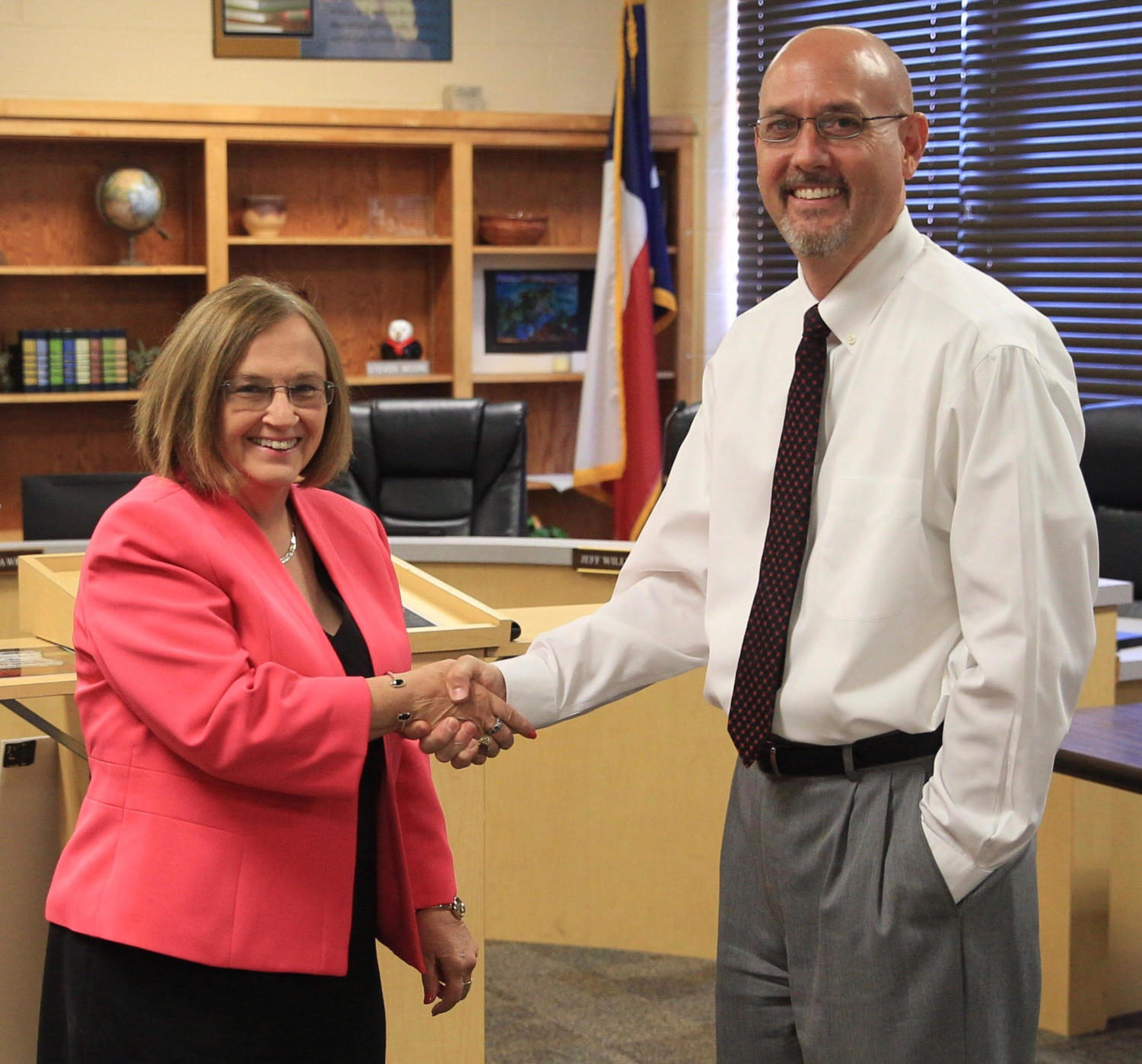 Superintendant Dr. Wright and Mr. King celebrate his announcement as new principal.