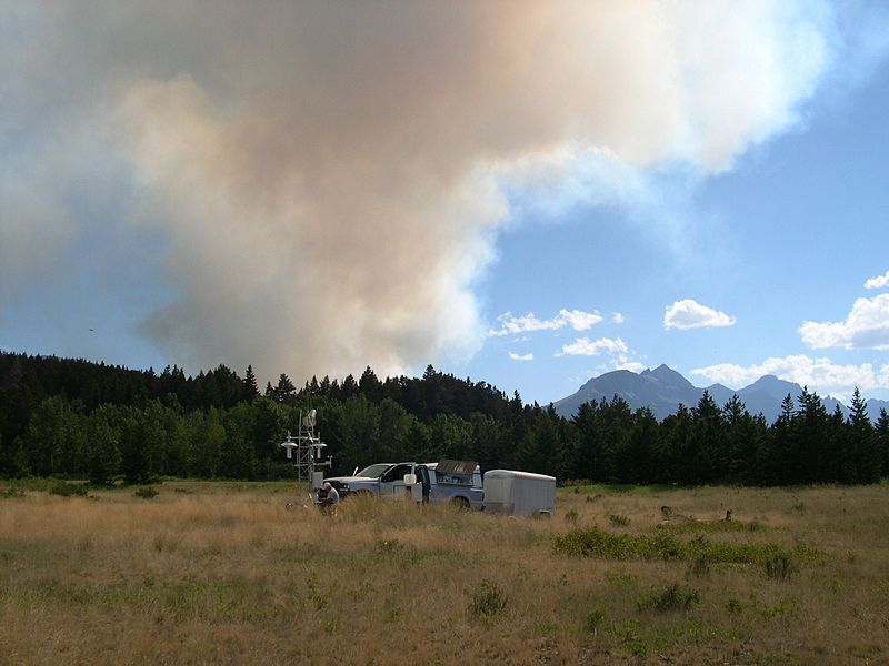 Site+maintenance+being+performed+at+a+U.S.+Climate+Reference+Network+%28USCRN%29+station.+The+visible+smoke+in+the+background+is+from+a+forest+fire+in+Glacier+National+Park%2C+a+fire+which+led+to+the+evacuation+of+St.+Mary+Village+a+few+hours+after+the+photograph+was+taken.+Montana%2C+St.+Mary.+2006+July+29.