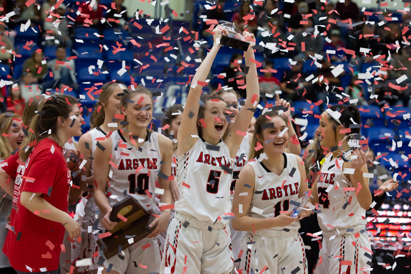 Junior Rhyle McKinney holds up the regional championship trophy after the Argyle Lady Eagles defeat the Levelland Loboettes in the Region 1 class 4A Final Championship game at Lubbock Christian University in Lubbock, Texas, on February 23, 2019.(Andrew Fritz | The Talon News)