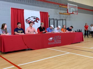 Eight seniors sign to their future colleges, on National Signing Day, on Wednesday, February 6.