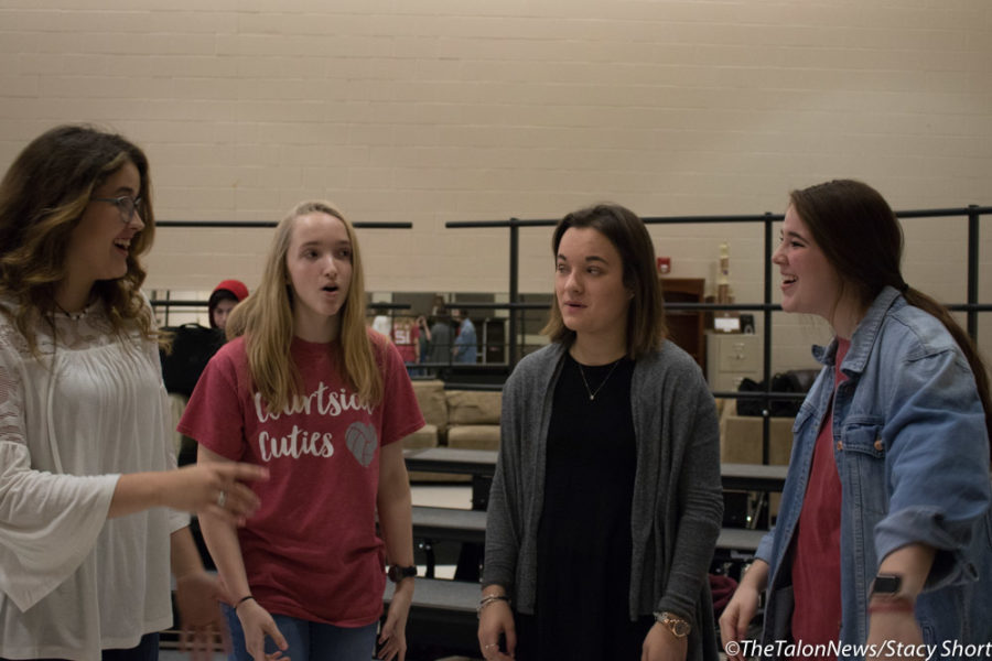 Members of Remedy sing at Argyle High School in Argyle, Texas.