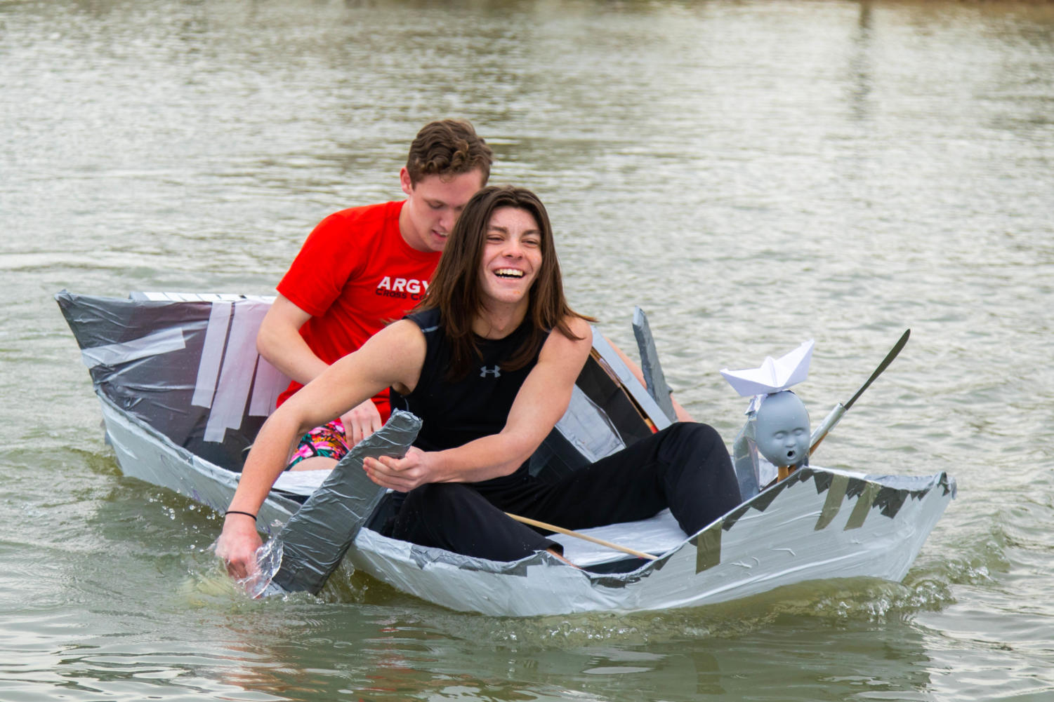 Senior Michael Gilbert and junior Dylan Hargroves race their class' boat on Feb. 26, 2019. (Campbell Wilmot/ The Talon News).