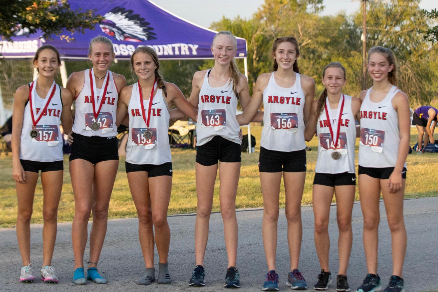 The Argyle Eagles Cross Country team shows off their medals at the Gingerbread Jamboree at Camp Copass in Denton, Texas, on August 29, 2019. (Andrew Fritz | The Talon News)