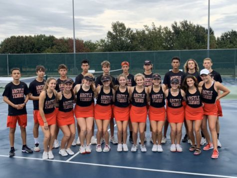 The Tennis Team poses after winning the Bi-District championship. (Photo courtesy of Tobi Jordan)