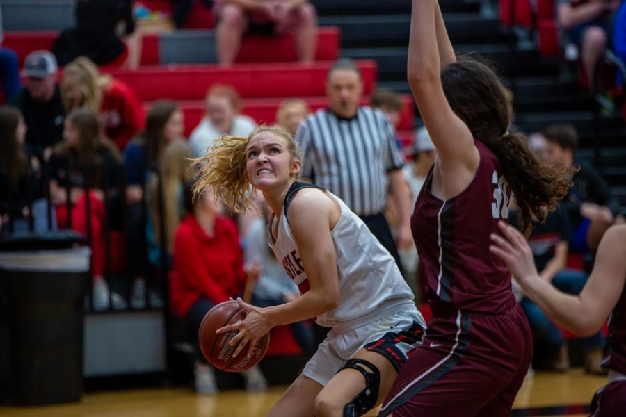 Junior Shelby Henches concentrates as she begins a layup against the Bridgeport Sissies on Jan. 10, 2020. (Alex Daggett / The Talon News)