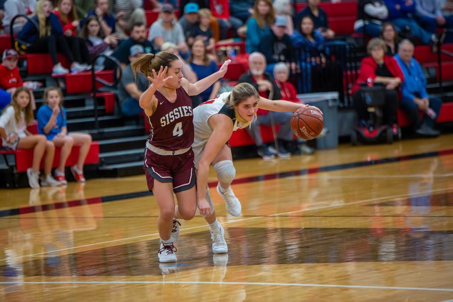 Senior Brooklyn Carl breaks away from the defender during the game against the Bridgeport Sissies on Jan. 10, 2020. (Alex Daggett / The Talon News)