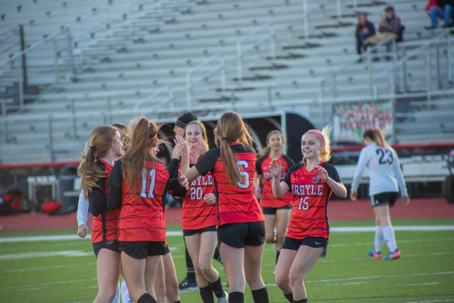 The Lady Eagles celebrate after beating Springtown 7-0 on February 21, 2020 at Argyle High School. (Alex Daggett / The Talon News)