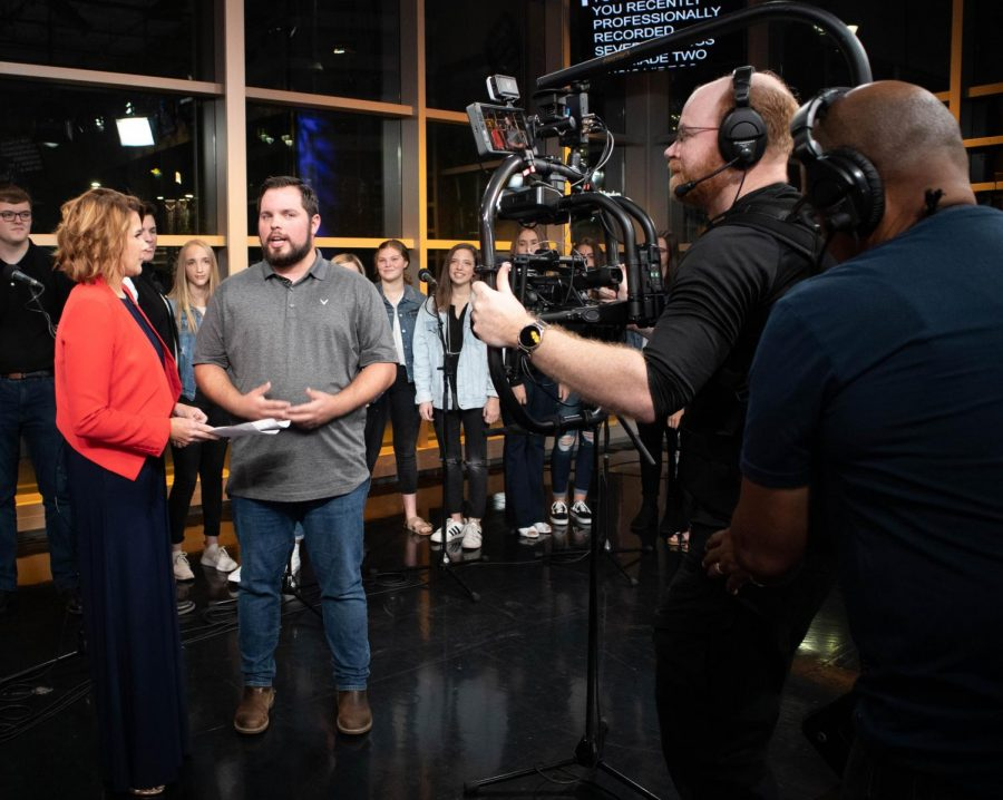 Choir Director Will Griswold speaks with News 8 Daybreak reporter Kara Sewell. Argyle's High School's a cappella group, Remedy, had a chance to appear on the show on Sept. 20, 2019. (Jaclyn Harris | The Talon News)