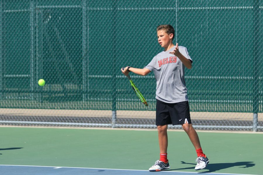 Freshman Nick Loveday competes in a tennis match at Argyle High School in Argyle, Texas on Oct. 19, 2017. (Jaclyn Harris | The Talon News)