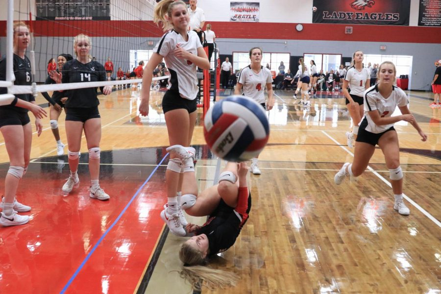 Sophomore Jada Price dives for the ball during the Sawyer Camillo Memorial Tournament at Argyle High School in Argyle, Texas on Aug. 23, 2019. (Jaclyn Harris | The Talon News)