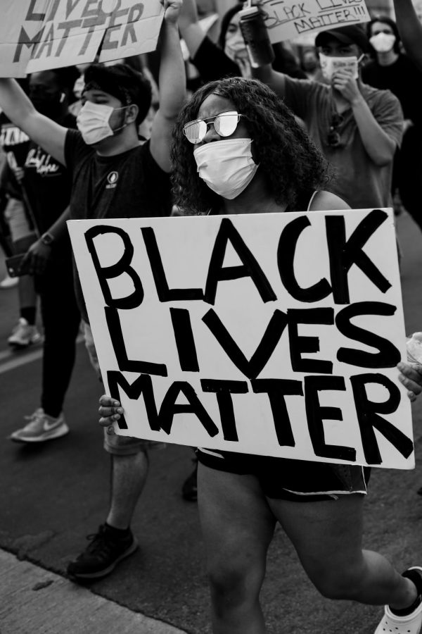 A protester holds a sign at the Black Lives Matter rally in the Denton square on Monday, June 1 2020.