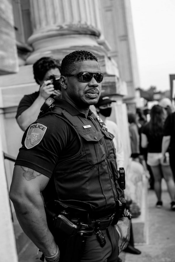 A police officer acting as secutiry at the Black Lives Matter rally in the Denton square on Monday, June 1 2020.