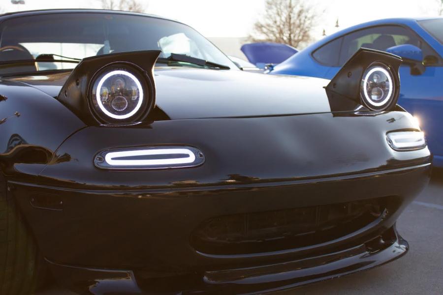 This Mazda Miata reflecting the sun awaiting for people to admire. (Jacob Lormand I The Talon News)