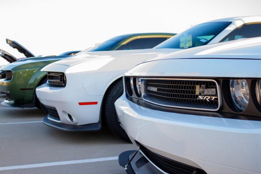 Lineup of three beautiful Dodge Challengers at Dallas Fueled Up Car Meet. (Jacob Lormand I The Talon News)
