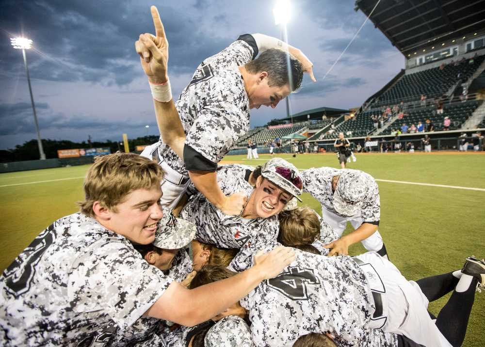 The Argyle Eagle baseball team celebrates their victory in the UIL State Championship Final against West Orange-Stark on June 11, 2015 at the UFCU Disch-Falk Field in Austin, Texas. (Chris Piel/The Talon News)
