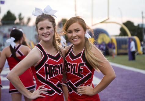 Juniors Allison McNiel and Haylee Holt enjoy pregame pictures before Argyle takes on Abilene Wylie at Bobcast Stadium on August 28, 2015. (Annabel Thorpe / The Talon News)