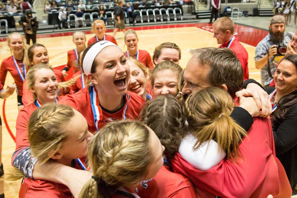 Junior Halee Van Poppel jumps in the group after defeating Bushland 3-0 in the 4A state championship on Saturday, Nov. 21 at Curtis Culwell Center in Garland, TX. (Caleb Miles / The Talon News)