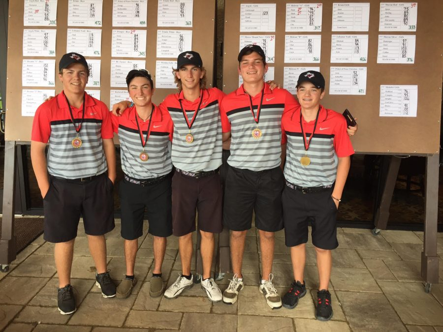The+boys+%22red%22+golf+team+pose+in+front+of+the+team+scores%2C+where+they+took+first+place+at+the+Robson+Ranch+golf+tournament+on+Sept.+26+at+Robson+Ranch+in+Argyle%2C+TX.+Photo+by+Brady+Bell%2FSpecial+contributor