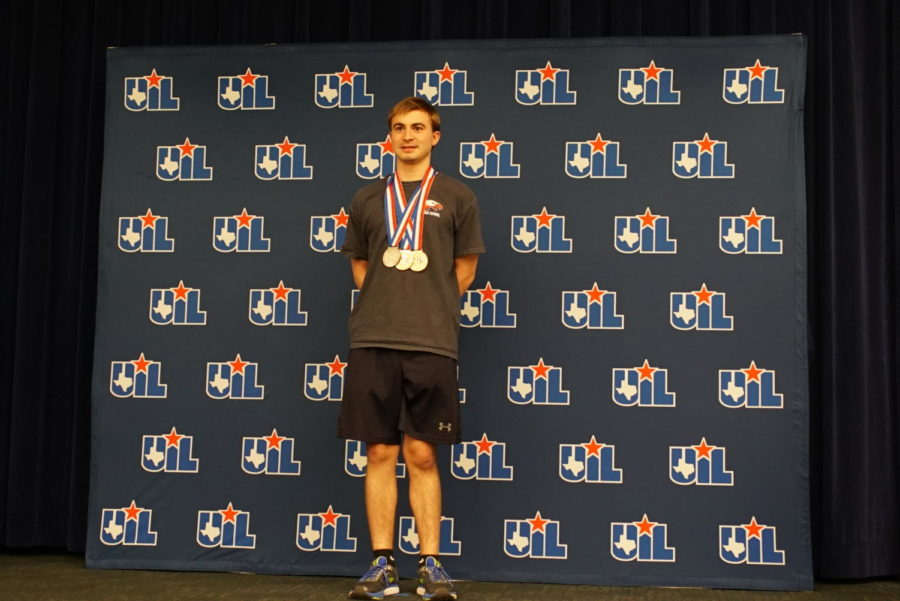 Senior+Andrew+Hennes+is+awarded+for+his+accomplishments+at+the+UIL+State+Academic+Meet+in+2017+in+Austin%2C+TX.+%28Stacy+Short%2FThe+Talon+News%29