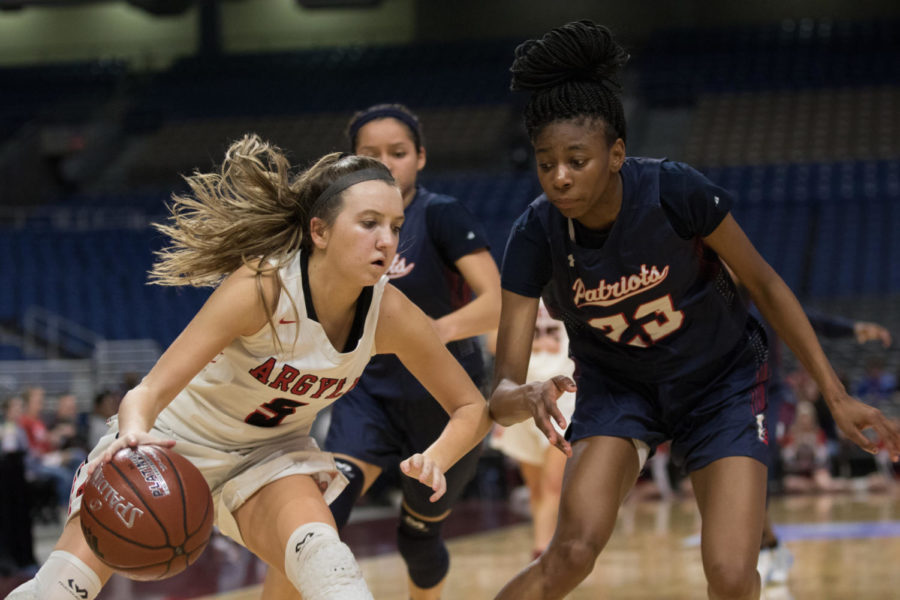 Rhyle Mckinney dribbles down the court as the Lady Eagles take on Veteran's Memorial in the UIL State Championship game. The Lady Eagles take the game with a final score of 60-41. (Campbell Wilmot (Campbell Wilmot/ The Talon News)