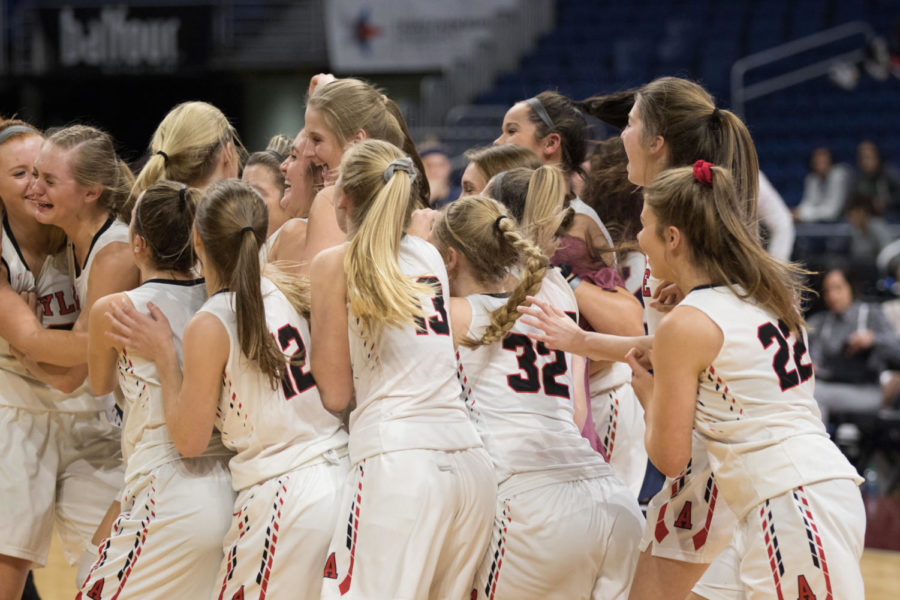 The Lady Eagles celebrate after they win the UIL State Championship game with a final score of 60-41 against Veteran's Memorial. (Campbell Wilmot/ The Talon News)