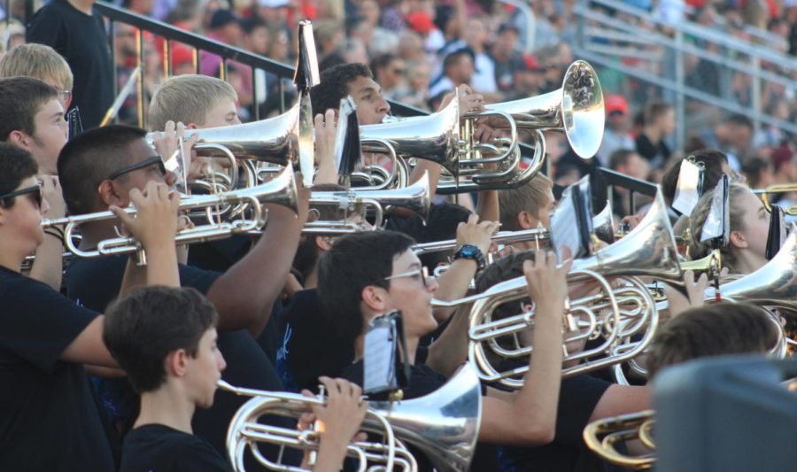 Music blaring but unheard, band students play in the new band stands on August 31, 2018. Photo by: Grey Mashrouteh for The Talon News