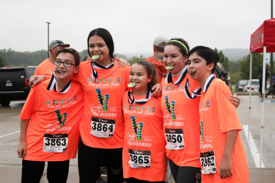 Community members compete in the sixth annual Run For Our Sons. (Ella Sheridan/ The Talon News)