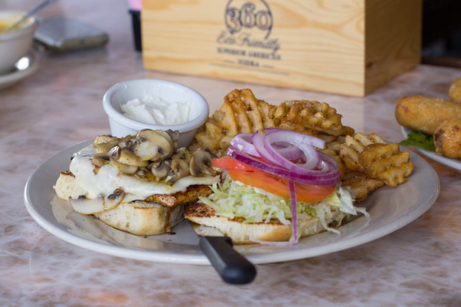 The mushroom chicken burger with fries is a fan favorite at Cafe Gecko in Plano, Texas, on Sept. 29, 2018. (Sloan Dial / The Talon News)