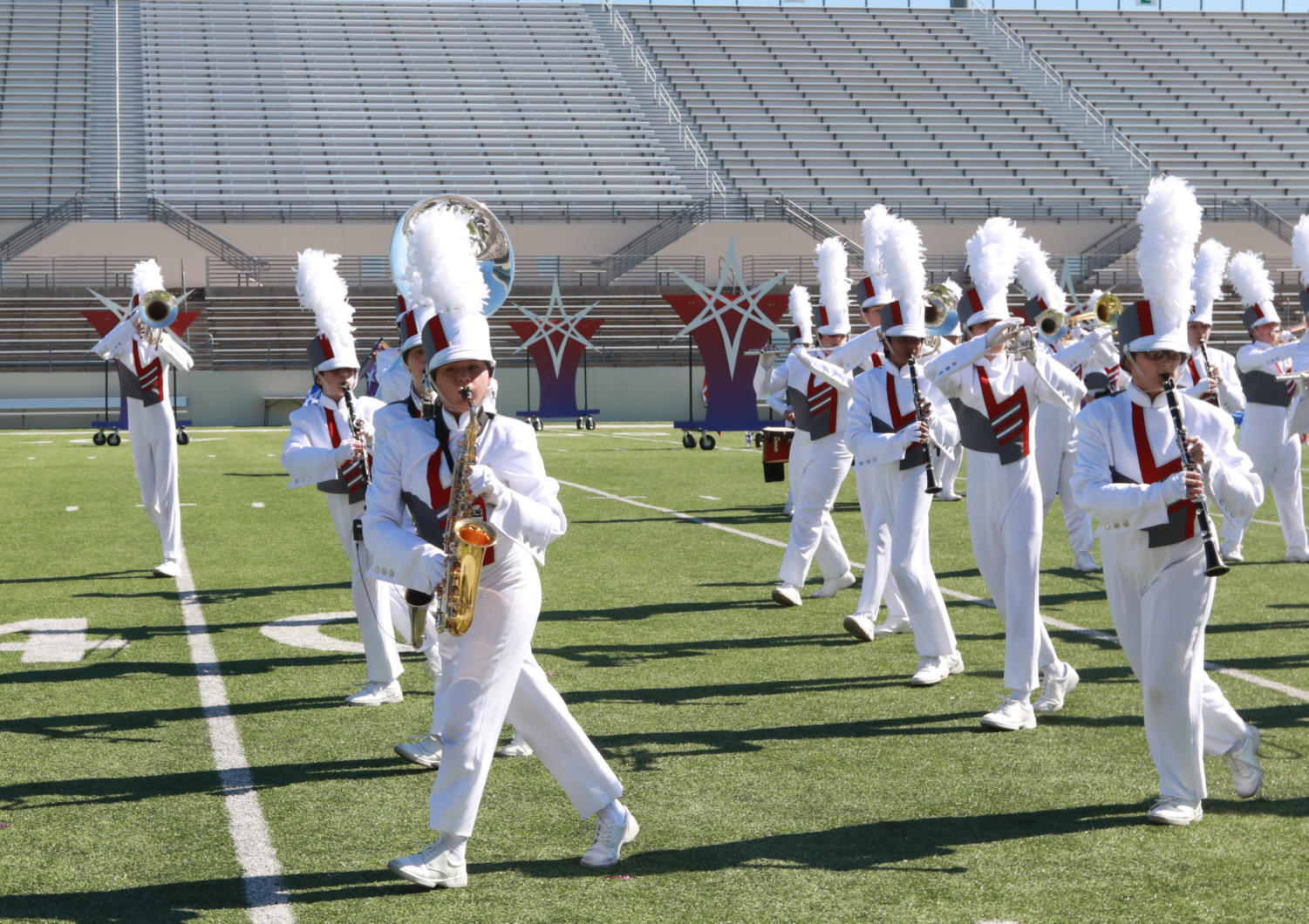 Putting thier hearts into the performance, stundets of the marching band preform at the Area Marching Contest prior to State. (The Talon News / Jaclyn Harris)